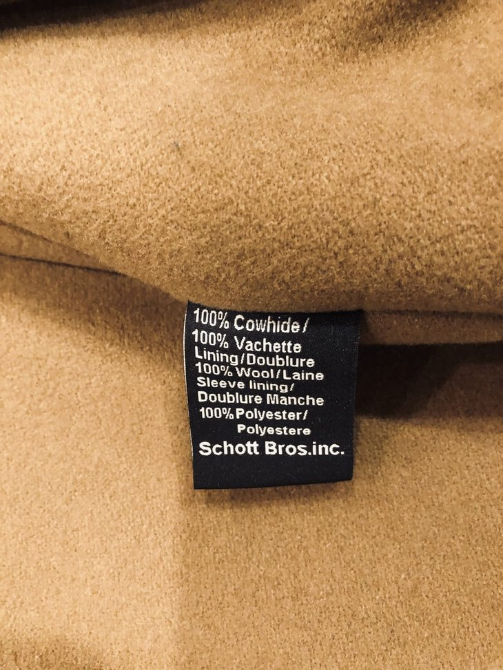 Tag inside a black Schott leather coat.