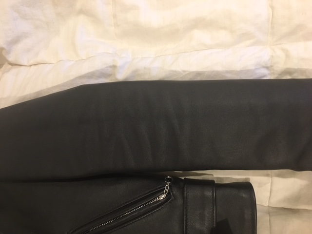 Arm of a Perfecto 613 leather jacket